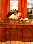 Me sitting in the president's desk of the oval office